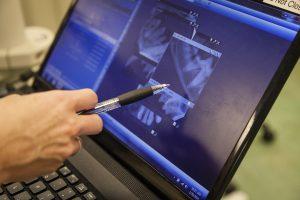 Veterinarian reviewing dental xray