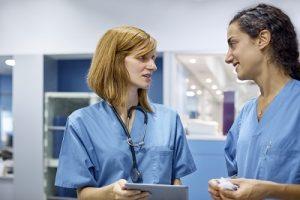 Two technicians talking.